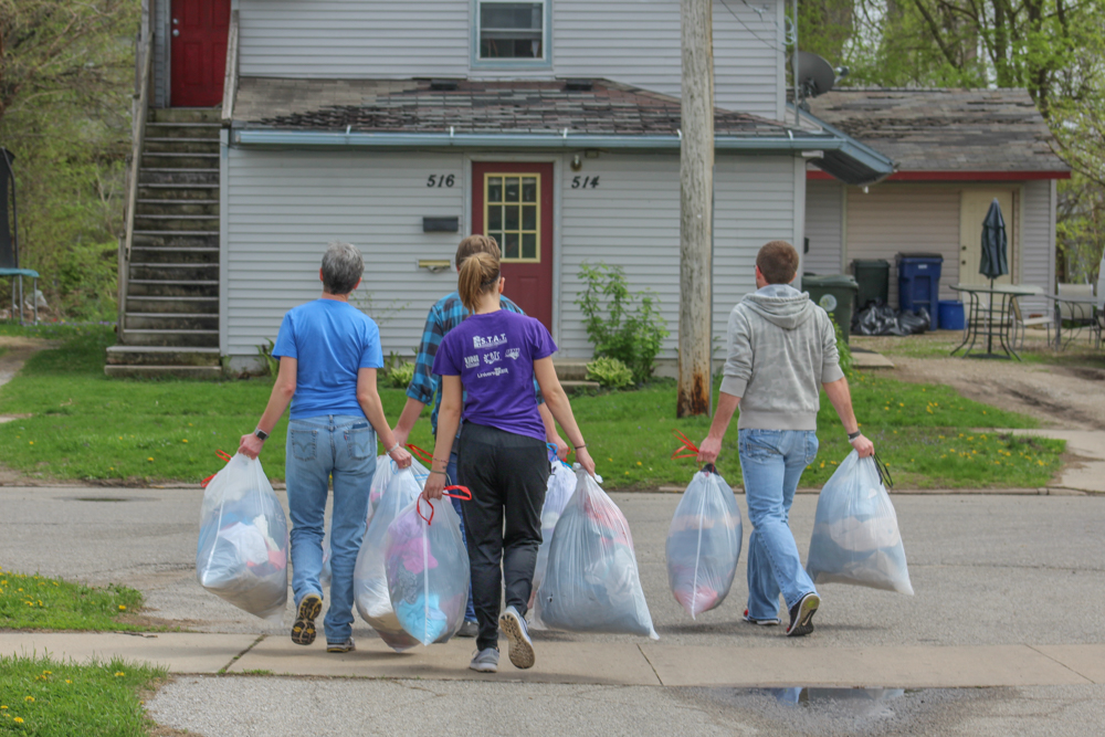 Far Reach Team Carries Garbage Bags
